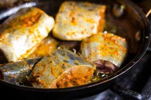 Spanish Mackerel frying in pan